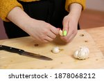 young woman cooking in a...