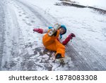 woman is lying on a icy on road....   Shutterstock . vector #1878083308