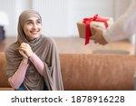 Muslim Woman Receiving Wrapped...