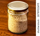 Sesame Seeds In A Jar With A...