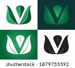 vegan v leaf logo concept with... | Shutterstock .eps vector #1879755592