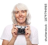 An Elderly Woman Is Holding A...
