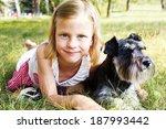 smiling little girl hugging her ... | Shutterstock . vector #187993442
