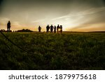 a group of people at sunset | Shutterstock . vector #1879975618