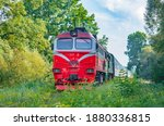 A Red Long Passenger Train In...