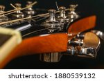 Close Up Of A Guitar Head With...