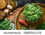Small photo of Arabic Cuisine; Egyptian organic jute leaves, Jew's mallow or (Molokhia). Those leaves are nutrient leafy greens full of phytonutrients that support heart health and immunity. Top view with close up.