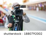 video camera operator working... | Shutterstock . vector #1880792002