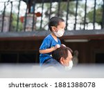 asian preschool boy riding on... | Shutterstock . vector #1881388078