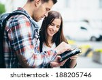 couple of tourists looking at... | Shutterstock . vector #188205746