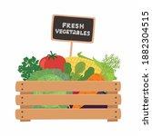 fresh vegetables a wooden box.... | Shutterstock .eps vector #1882304515