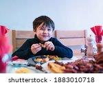 Happy Kid Eating Sunday Dinner...