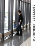 family looking at aircraft in... | Shutterstock . vector #188323052