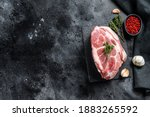 Small photo of Raw pork neck meat. Chop steak. Black background. Top view. Copy space