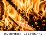 Fire in a kitchen stove, with firewood burning