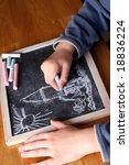 Kid drawing on a blackboard - stock photo