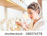 woman in bath robe choosing... | Shutterstock . vector #188376578