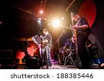 Band performs on stage, rock music concert in a nightclub - stock photo