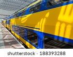 big yellow train at a dutch... | Shutterstock . vector #188393288