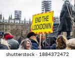 Small photo of LONDON, ENGLAND- 14 December 2020: Anti-lockdown protesters at a protest in Parliament Square, organised by the National Alliance for freedom from lockdowns