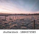 A Frozen Misty Field At Sunrise....