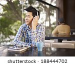 young man wearing headphone... | Shutterstock . vector #188444702