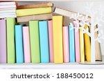 books on shelf close up | Shutterstock . vector #188450012