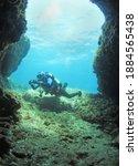 A Scuba Diver Enters The...