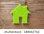 Green Small House On Wooden...