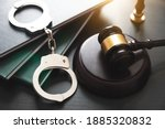 Handcuffs and wooden gavel....