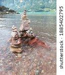stone scultpure beach sky water