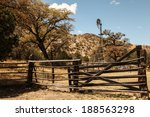 Windmill And Old Wooden Gates...
