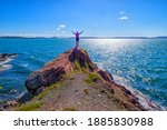 A Female Hiker Stands On A...