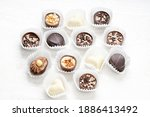 different chocolate pralines.... | Shutterstock . vector #1886413492