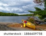 A Resting Yellow Canoe  With...