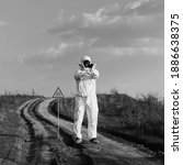 Scientist in radiation suit and ...