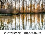 Lake With Mirror Reflection On...