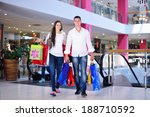 happy young couple with bags in ... | Shutterstock . vector #188710592