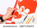 the girl cuts out a heart shape ... | Shutterstock . vector #1887140695