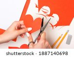 the girl cuts out a heart shape ... | Shutterstock . vector #1887140698