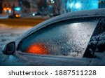Frozen Car Glass With Ice And...