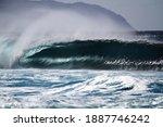 An Unridden Wave Barrels Over...