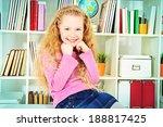cute joyful girl sitting on a...   Shutterstock . vector #188817425
