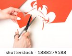 the girl cuts out a heart shape ... | Shutterstock . vector #1888279588