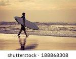 Silhouette Of A Surfer Walking...