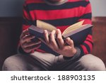 closeup on a man reading a big... | Shutterstock . vector #188903135
