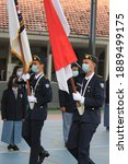 Small photo of Yogyakarta, Yogyakarta, Indonesia - January 08th, 2021: platoon troop core of SMAN 2 Yogyakarta was carrying the national flag of Indonesia