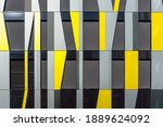 Small photo of Yellow and Gray Decorative Facade Cladding Panels of Irregular Shapes. Geometric Facade. Modern Building. Abstract Architecture Photography.