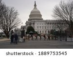 Small photo of Washington, DC – January 8, 2021: National Guard troops guarding the perimeter security fence at the U.S. Capitol.