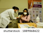 Small photo of New Delhi, India. 08 January 2021. Health officials and volunteer take part in dry run or a mock drill for the coronavirus (COVID-19) vaccine delivery, at a Hospital.